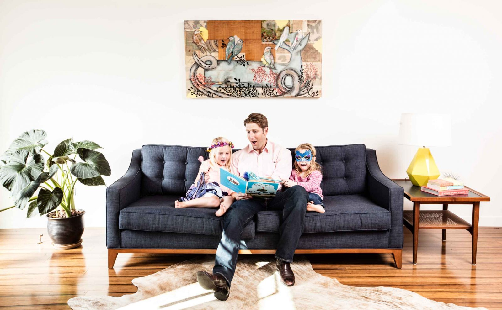 Father and children sitting on designer couch